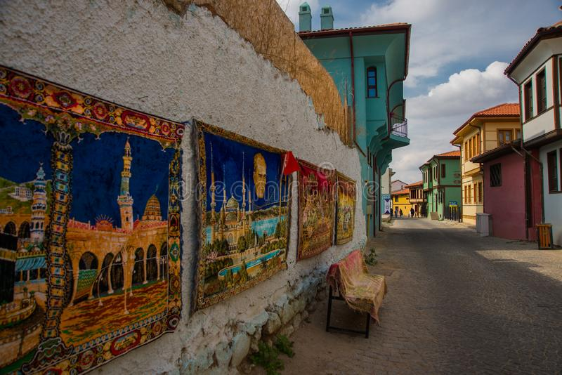 Traditional rugs with a landscape. Historical Homes and street from Odunpazari. Eskisehir. Turkey. Traditional rugs with a landscape. Historical Homes and street stock images