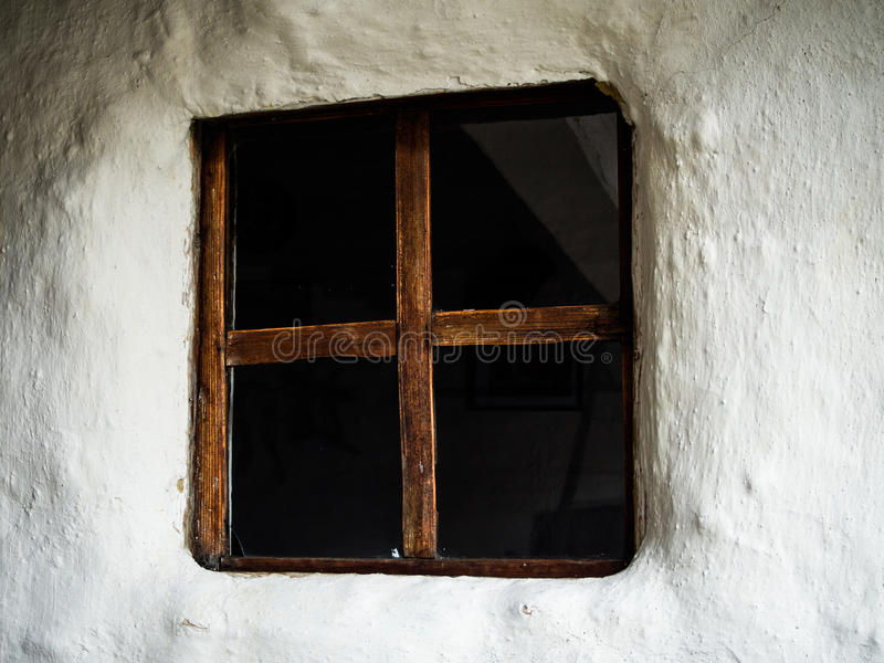Traditional, rural house window, white wall royalty free stock photo