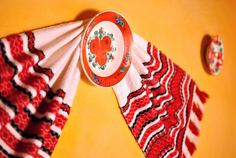 Traditional rural objects. Romanian traditional rural objects: towel, painted plates royalty free stock images