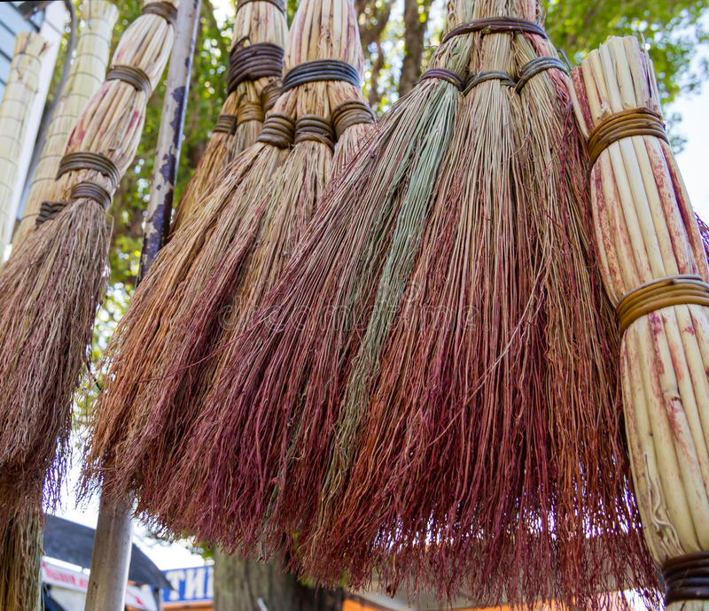 Traditional Russian brooms hang over the market counter stock photo
