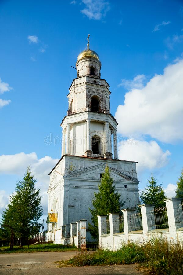 Traditional russian church with domes in a village. Architecture in the Orthodox religion. Traditional russian church with domes in a village in a sunny summer stock photo