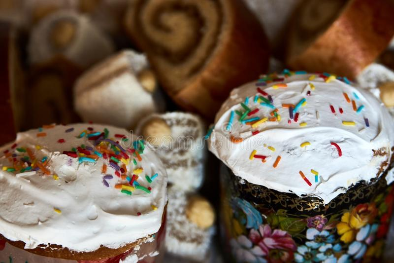 Traditional Russian Easter cakes kulich, with colored eggs, close-up royalty free stock image