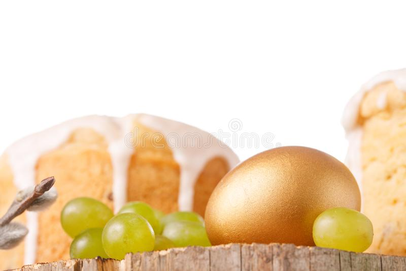 Traditional Russian Easter cakes kulich, with colored golden egg on a wooden background. Close-up stock photos