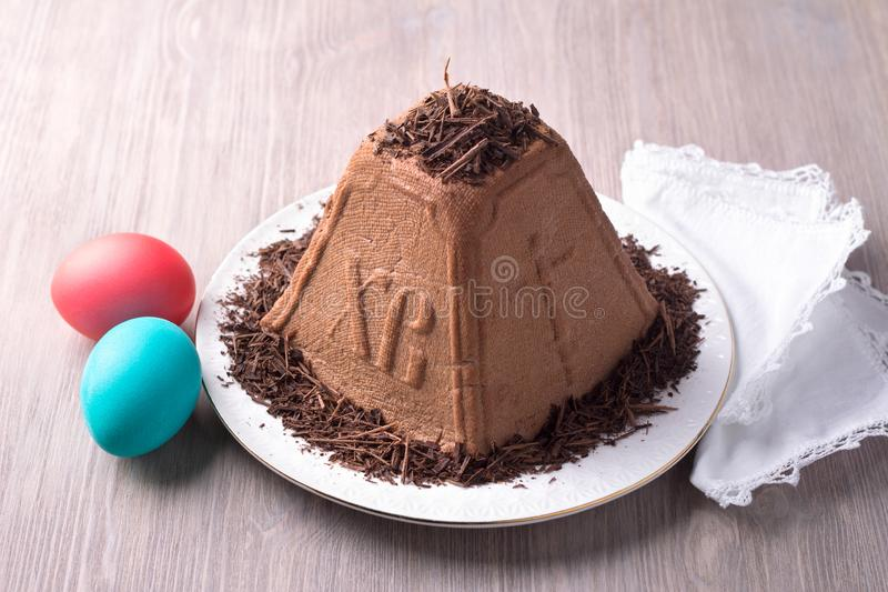 Traditional Russian Easter cottage cheese dessert, Orthodox Paskha, with chocolate and colored eggs royalty free stock image