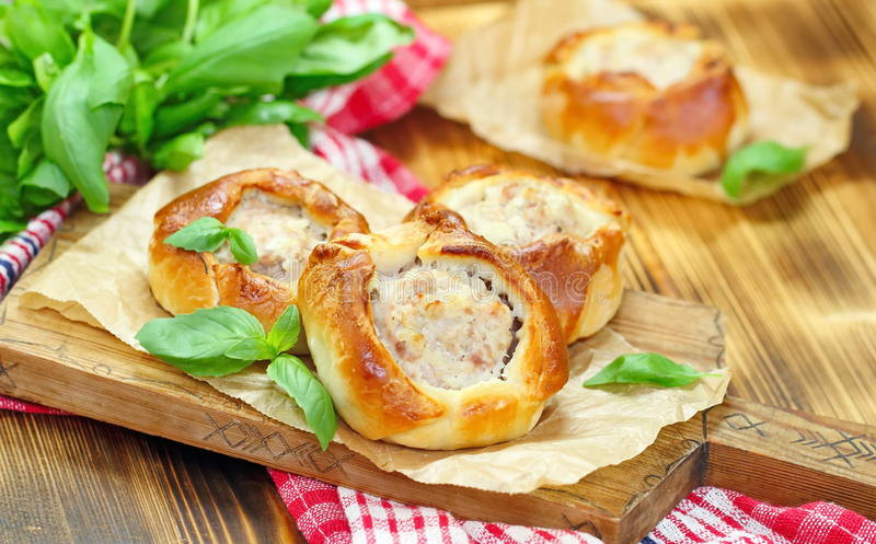 Traditional russian meat pies belyashi stock photo