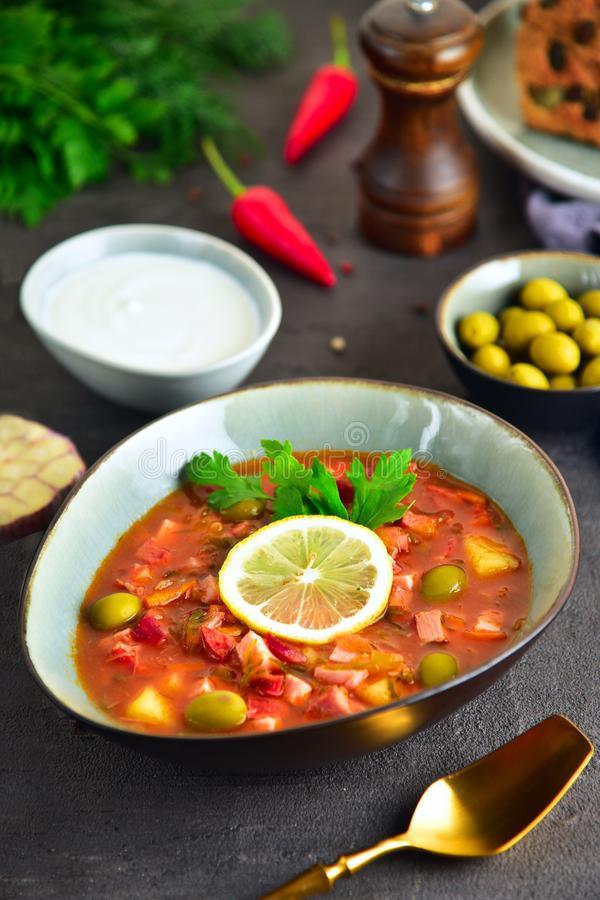 Traditional russian meat soup solyanka. The finished dish. Close-up. royalty free stock photography