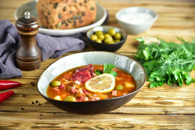 Traditional russian meat soup solyanka. The finished dish. Close-up. royalty free stock photo