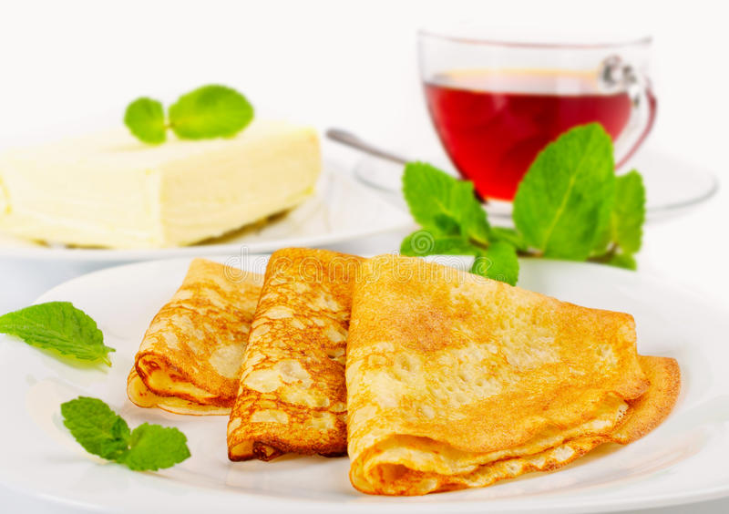 Traditional Russian pancakes. With butter and black tea royalty free stock photo