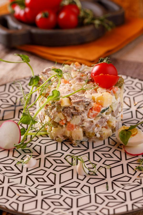 Traditional Russian salad Olivier for the festive table. Dish for the restaurant royalty free stock photo