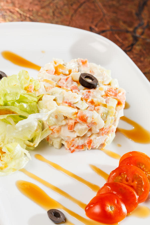 Traditional Russian salad. On plate stock photos