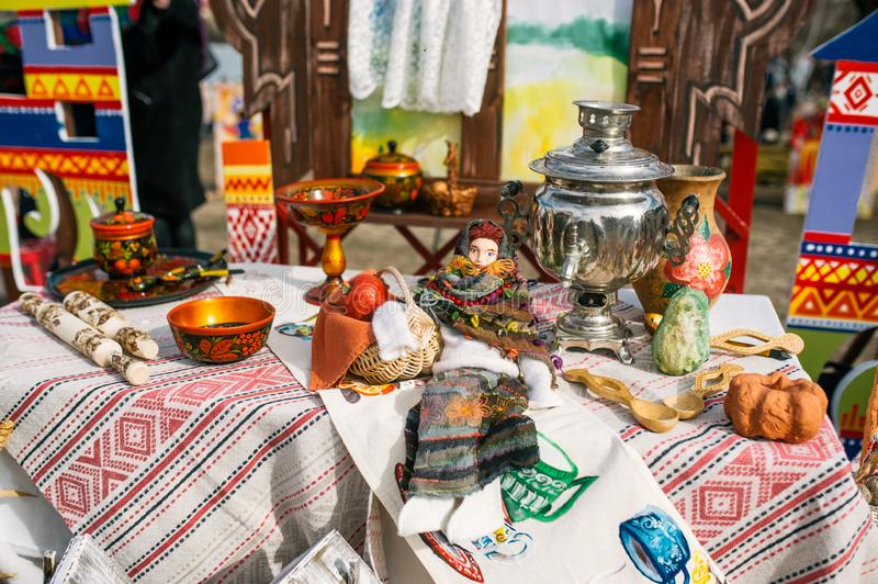 Traditional Russian Tea Party including hot black tea from samovar. Decoration on wooden table royalty free stock image