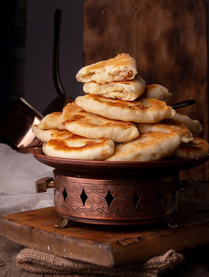 Traditional russian ukrainian food pirozhki small portion pie with potato stock images