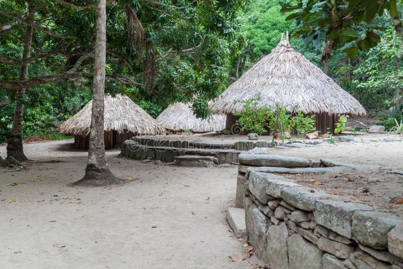 Traditional rustic houses of indigenous Kogi people. In Tayrona National Park, Colombia royalty free stock photo