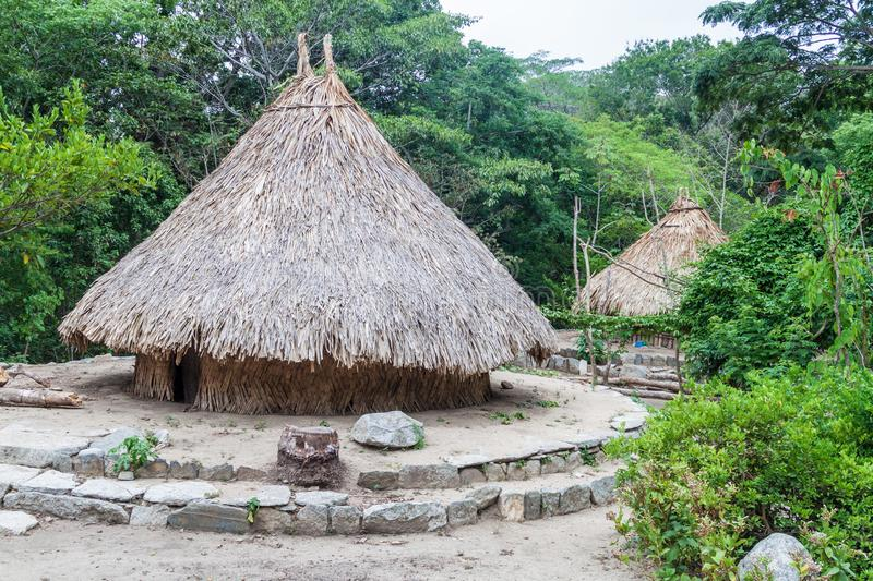Traditional rustic houses of indigenous Kogi people. In Tayrona National Park, Colombia stock photo