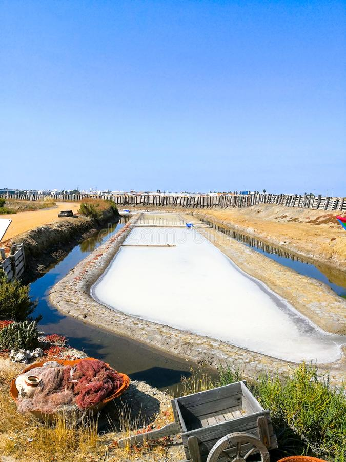 Traditional saltworks. Isla Cristina, Huelva, Spain. Deposits sediments, canals and mud flats. Southern Andalusia saltworks.  royalty free stock photos