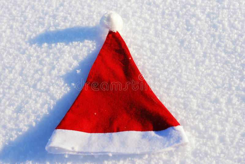 Traditional Santa hat on winter background stock images