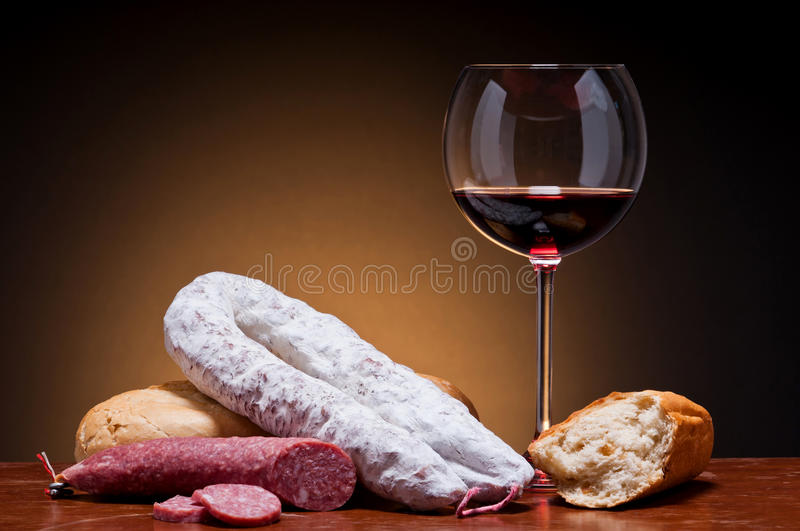 Traditional sausages and wine stock images