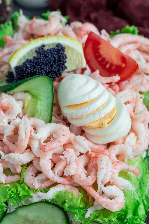 Traditional savory swedish sandwich cake Smorgastorta with a bread, shrimps, eggs, caviar, dill, mayonnaise, cucumber and lettuce royalty free stock photography