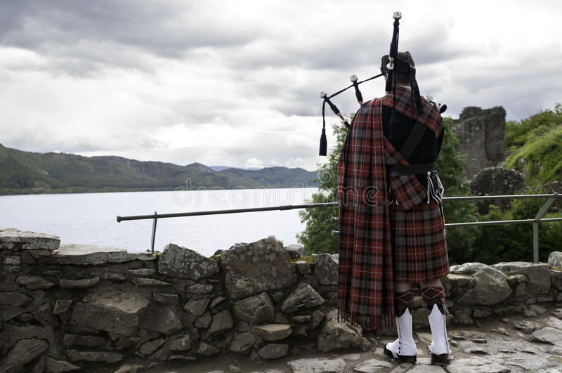 Traditional scottish bag piper. Standing on old castle royalty free stock images