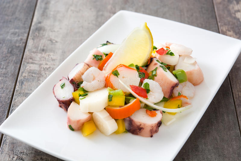 Traditional seafood ceviche from Peru. On wooden background royalty free stock photo