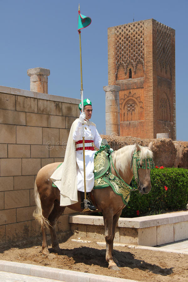 Traditional sentry at Hassan Tower, Morocco. Sentry dressed in traditional clothing at Hassan Tower, Morocco. Hassan Tower is the minaret of an incomplete mosque stock photos