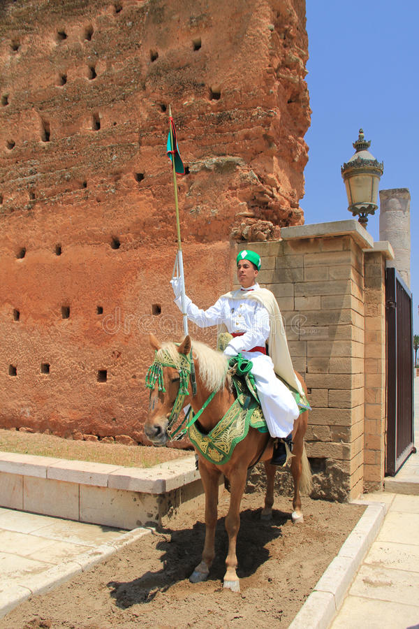 Traditional sentry at Hassan Tower, Morocco. Sentry dressed in traditional clothing at Hassan Tower, Morocco. Hassan Tower is the minaret of an incomplete mosque stock photo