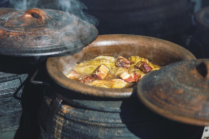 Traditional Serbian wedding cabbage boiled in earth cauldrons on simmering ashes. Outdoors,  selective focus stock photos