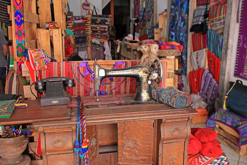 Traditional sewing machine and colorful blankets, Panajachel market, Guatemala stock photos