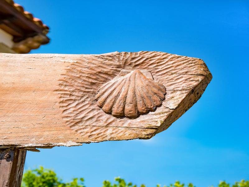Traditional shell sign on the way. Direction sign for pilgrims in Saint James way, Camino de Santiago de Compostela, Spain.  stock photo