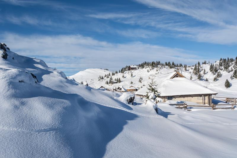 Traditional shepherd cottages covered with snow royalty free stock photo