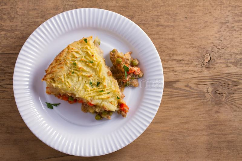 Traditional shepherd pie - popular dish in Ireland. Beef meat, mashed potato, cheese, carrot, onion and green peas casserole. royalty free stock image