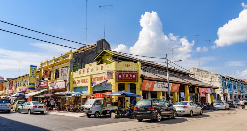 Traditional shop houses, Muar, Malaysia. Muar, Malaysia - 03 July 2016: Panorama view of traditional shop houses along historical street, Muar, Malaysia royalty free stock photos