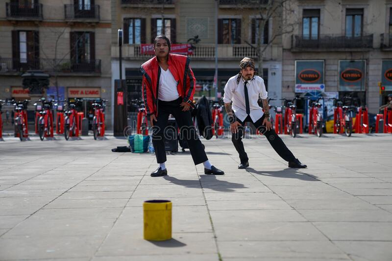 BARCELONA, SPAIN - MARCH 4, 2019: Young street dancers imitates Michael Jackson in the street in Barcelona, spain. These are traditional shows in historical royalty free stock photos