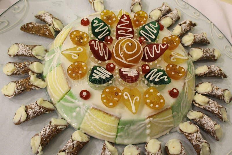 Traditional Sicilian cakes - Sicilian Cassata with small Cannoli royalty free stock photo
