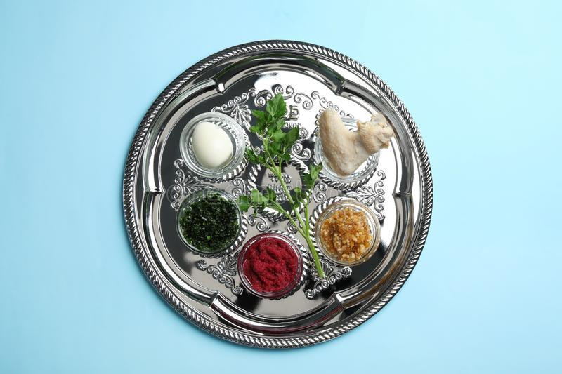 Traditional silver plate with symbolic meal for Passover Pesach Seder on color background stock images