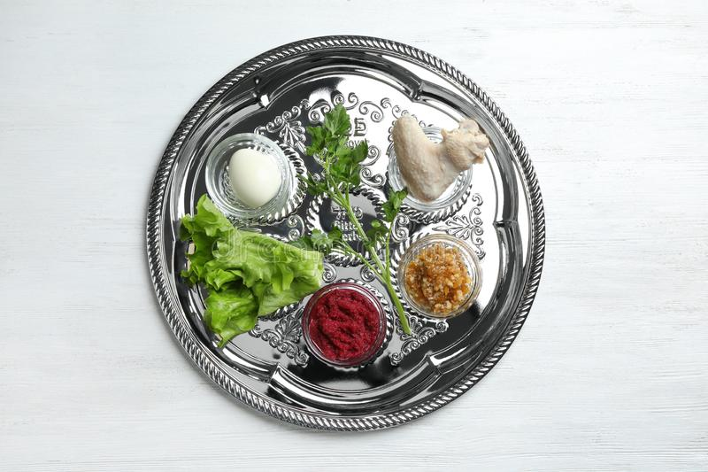 Traditional silver plate with symbolic meal for Passover Pesach Seder on wooden background. Top view royalty free stock image