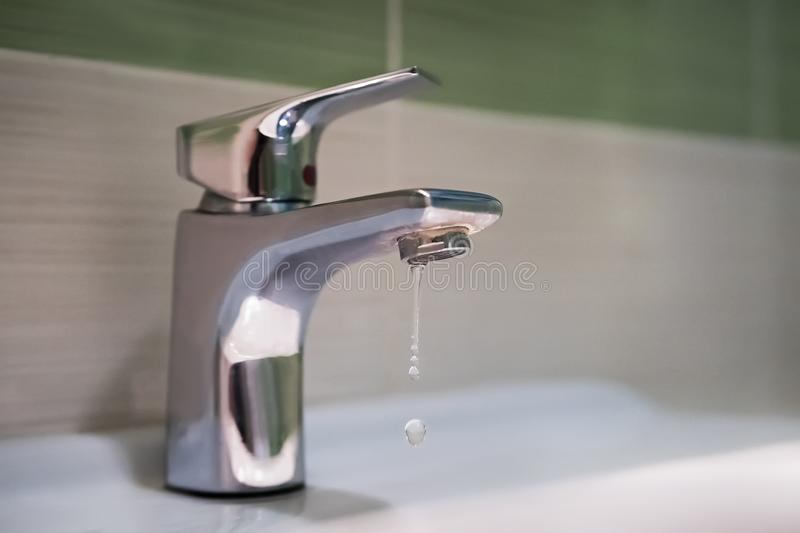 Traditional silver tap dripping stock photo