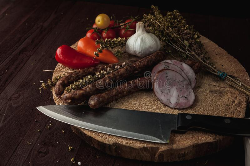 Traditional simple meal setup with meat and vegetables stock image