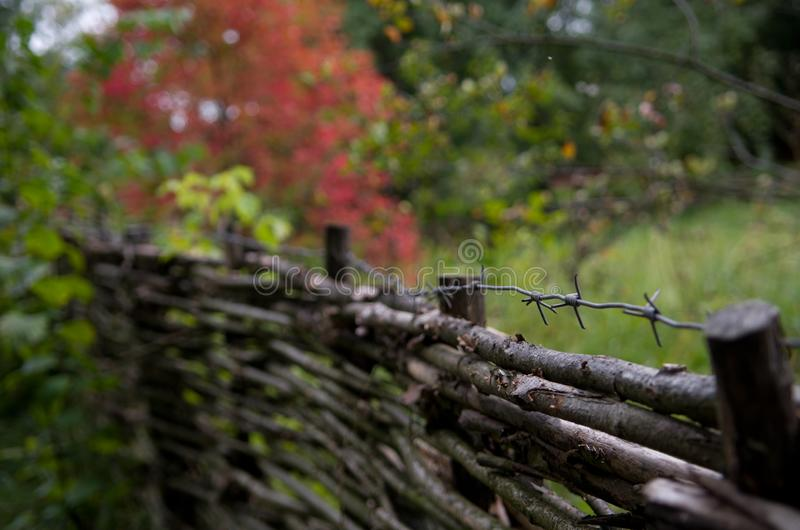 Traditional slavic fence in ethnographic park in Ukraine. Ethnic dwelling of the ancient Slavs stock photography