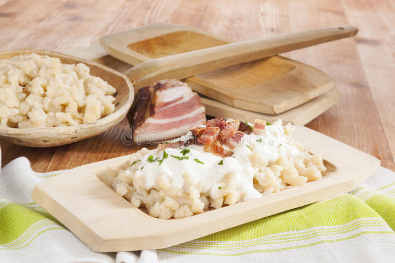 Traditional slovak eating, bryndzove halusky. Bryndzove halusky. Potato dumplings with bryndza sheep cheese and bacon. Bryndzove halusky, traditional national stock photo