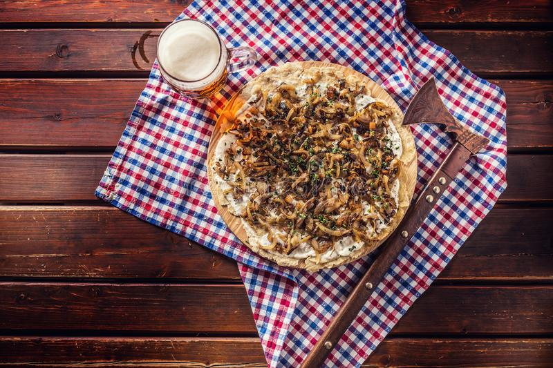 Traditional slovak potato pancake with fried onion bacon and che. Traditional slovak potato pancake with fried onion bacon and cream with draft beer royalty free stock images