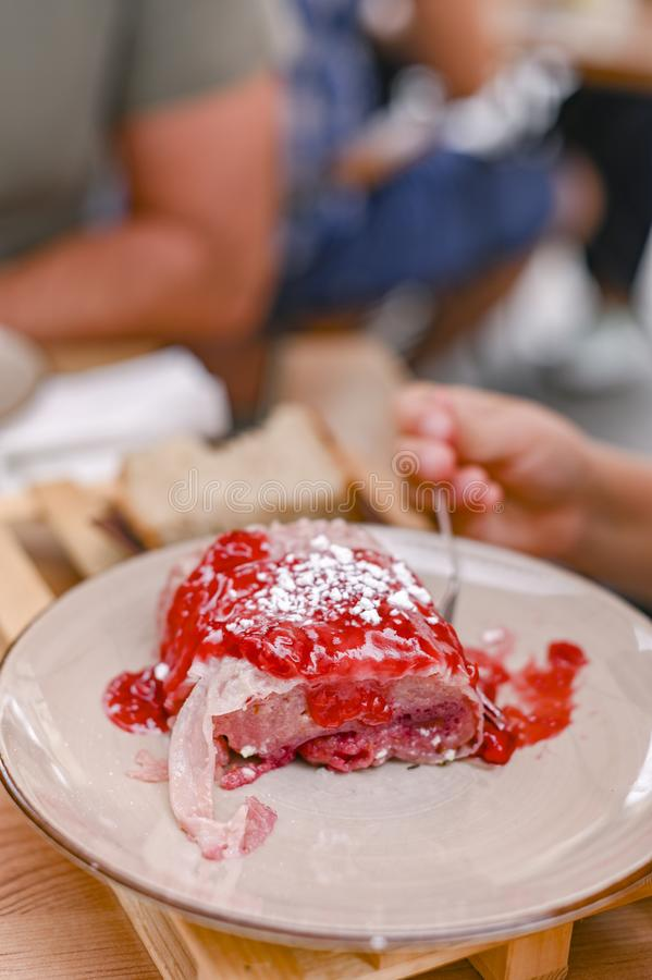 Traditional Slovenian dessert made of dough, cheese and fruit. Dumplings with raspberries for a delicious breakfast in a European stock photo