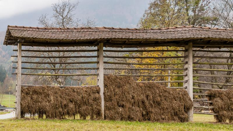 A traditional Slovenian drying frame hay rack called a kozolec in the countryside near Lake Bled, Slovenia, in the autumn season stock images