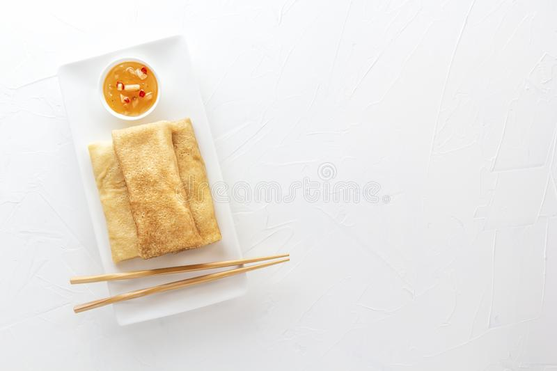 Traditional snacks of Chinese cuisine Dim Sum - tortillas - bings in a plate on a white background. royalty free stock photo