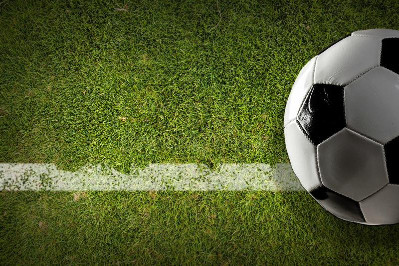 Soccer ball concept. Traditional soccer ball on soccer green field stock photography