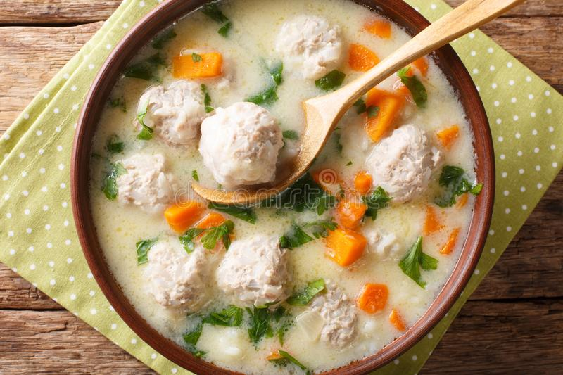 Traditional soup with meatballs, yogurt and vegetables close-up in a bowl. horizontal top view royalty free stock photos