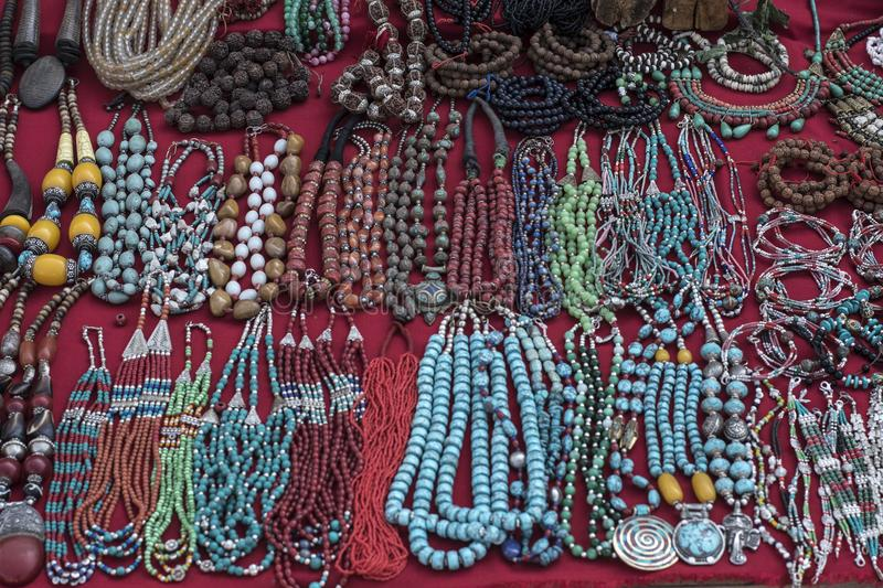 Traditional souvenir necklaces and hand bands in nepalese marketplace. Traditional souvenir necklaces and hand bands in nepalese street marketplace royalty free stock photo