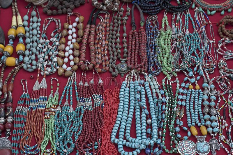 Traditional souvenir necklaces and hand bands in nepalese marketplace. Traditional souvenir necklaces and hand bands in nepalese street marketplace royalty free stock photography