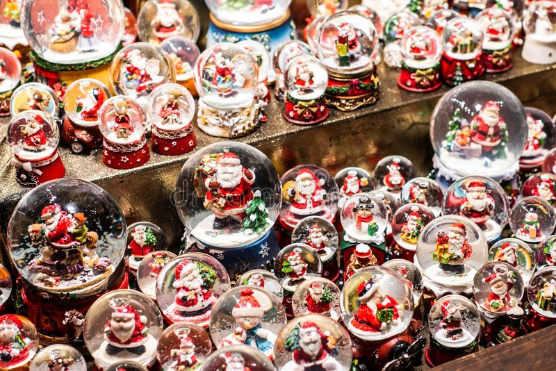 Traditional Souvenirs snow globes and toys Santa Claus Dolls At European Winter Christmas Market Souvenir royalty free stock photos