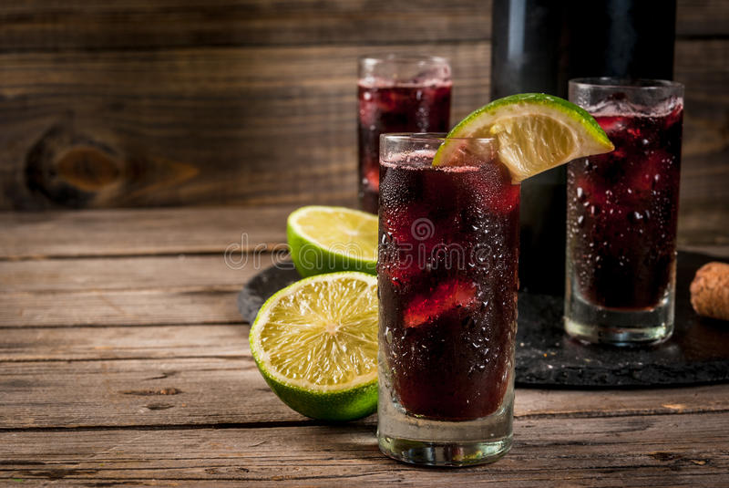 Traditional Spanish alcoholic cocktail, Calimocho. Traditional Spanish alcoholic drink, cocktail, Calimocho. With wine, cola, lime juice and ice. Decorated with stock photos